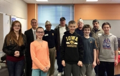 Members of VFW Post 8879 meeting with 7th grade students from Stilwell Jr. High School discussing military experiences, and our member's role in the VFW.